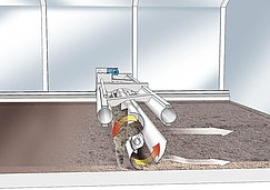 The rotating shovel of the turning device takes up the sludge and transports it along the granulation plate.